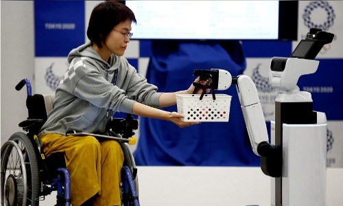 Human Support Robot delivers basket to woman in wheelchair